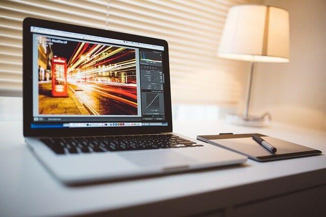 man on computer photo