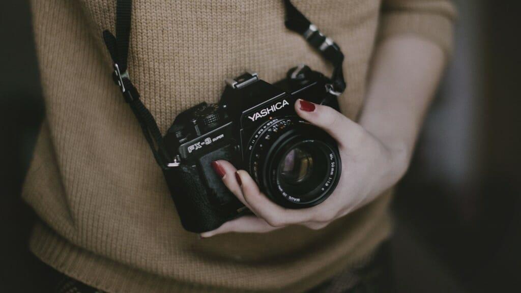 person-woman-hand-camera